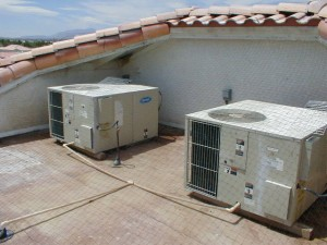 A recessed roof area with A/C units AFTER clean up & application of StealthNet